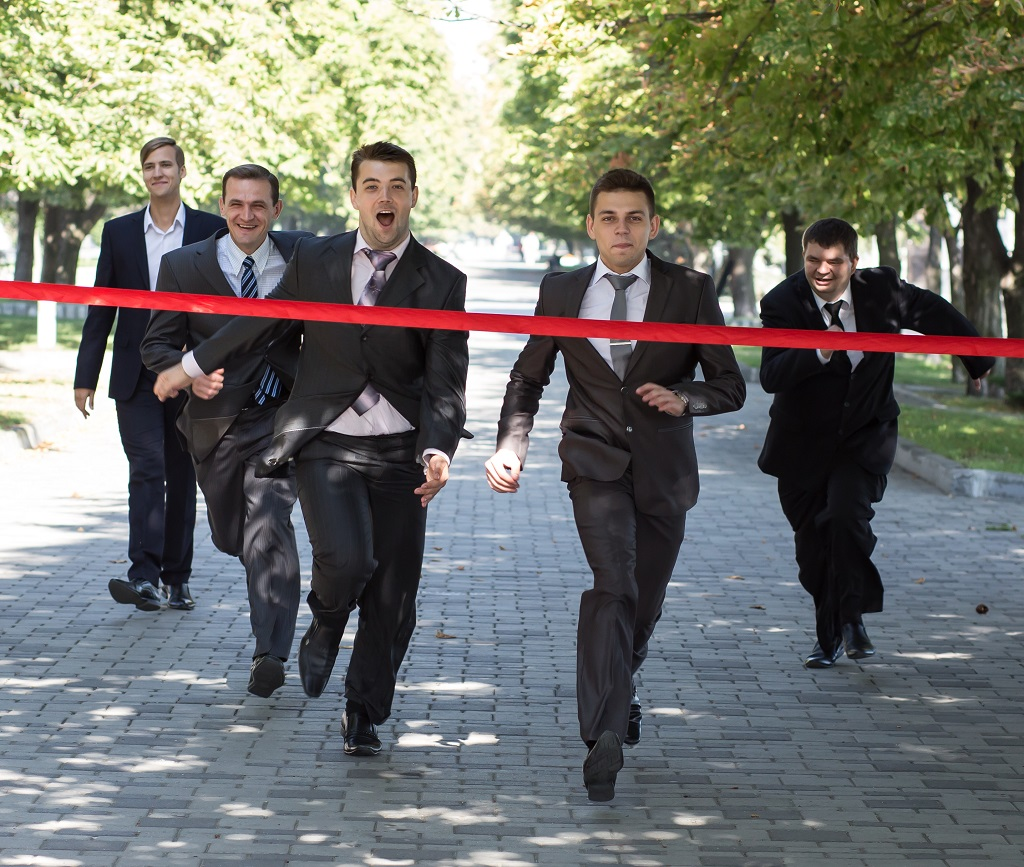 Business race. Business people are crossing red finish tape
